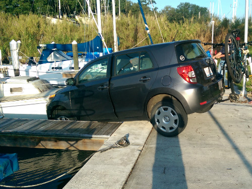 Scion xD hanging over the edge of the docks