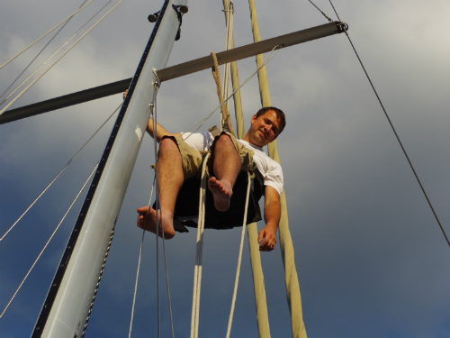 Dan going up the mast for the first time after borrowing a neighbor's block and tackle.