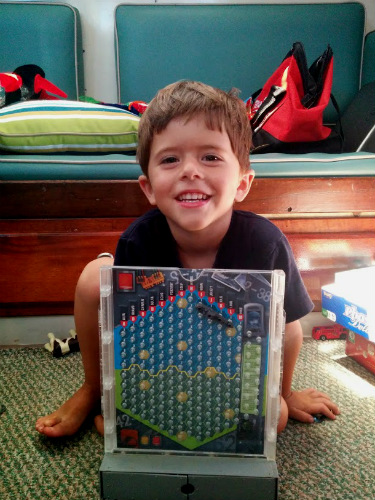 Some games come in more travel friendly shapes and sizes. This is our Battleship game.