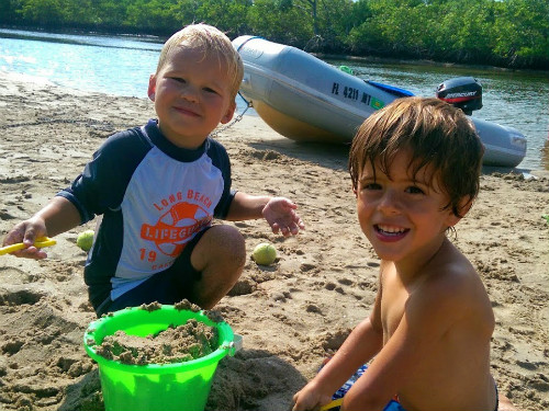 Ethan and Carter making castles on the beach.