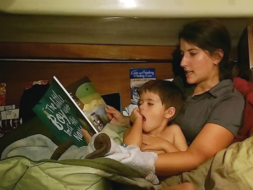"We got Carter a custom book called ""The Little Boy Who Lost His Name"". This is us reading it just before he finds out it is about him."