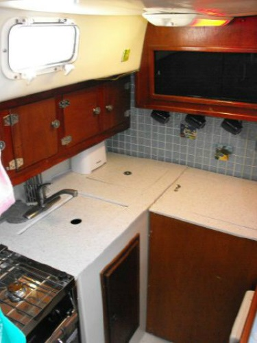 Our galley when we bought the boat. The deep freezer is in the cabinet on the right.