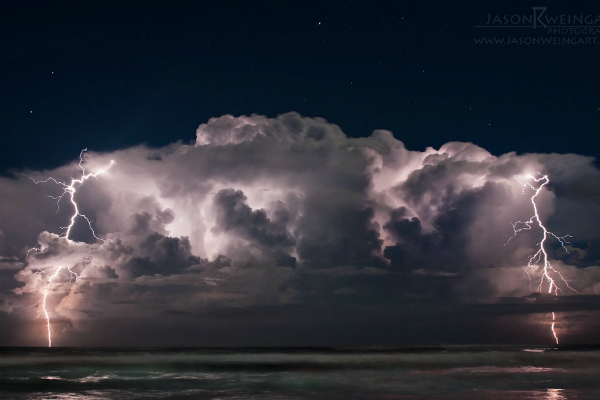 Thunderstorm over the Atlantic Ocean, off the coast of Ormond Beach, Florida. Taken by Jason Weingart.